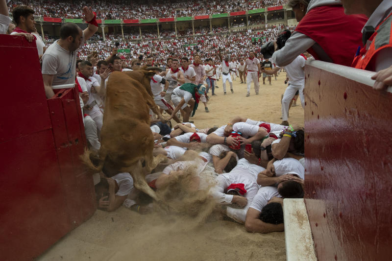 A heifer jumps over revellers in the bullring during the second day of the San Fermin Running of the Bulls festival on July 7, 2019 in Pamplona, Spain. (Photo: Pablo Blazquez Dominguez/Getty Images)
