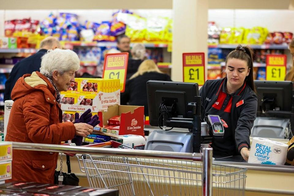 Elderly shoppers pay for their shopping at a branch of Iceland (Liam McBurney/PA) (PA Archive)
