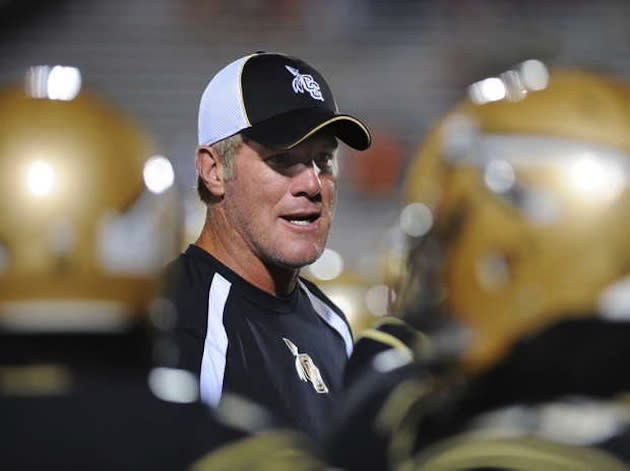 Brett Favre coaches on the sideline of Oak Grove High School — Associated Press