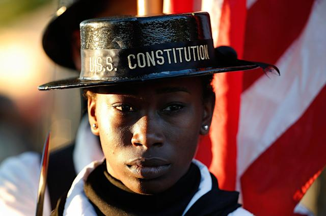 <p>Andrea Roberts-Davis, of Detroit, a sailor on the USS Constitution, stands in a color guard during rehearsal for the annual Boston Pops Fireworks Spectacular on the Esplanade, Monday, July 3, 2017, in Boston, Mass. (Photo: Michael Dwyer/AP) </p>