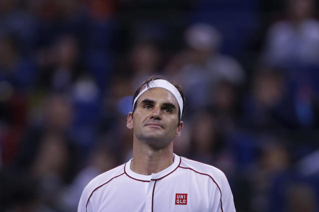 Roger Federer of Switzerland reacts during the men's singles match against David Goffin of Belgium at the Shanghai Masters tennis tournament at Qizhong Forest Sports City Tennis Center in Shanghai, China, Thursday, Oct. 10, 2019. (AP Photo/Andy Wong)
