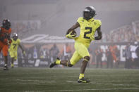 Oregon wide receiver Devon Williams (2) runs to the end zone for a touchdown reception during the first half of the team's NCAA college football game against Oregon State in Corvallis, Ore., Friday, Nov. 27, 2020. (AP Photo/Amanda Loman)