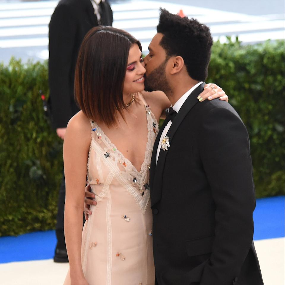 Selena Gomez and The Weeknd's relationship just keeps getting cuter and cuter. The two, who started dating in January, recently made their red carpet debut as a couple at the Met Gala, but they shared plenty of PDA-filled outings before then.