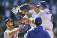 New York Mets' Michael Conforto (30) celebrates after being hit by a pitch and scoring the winning run on loaded bases during the ninth inning of a baseball game against the Miami Marlins, Thursday, April 8, 2021, in New York. (AP Photo/John Minchillo)