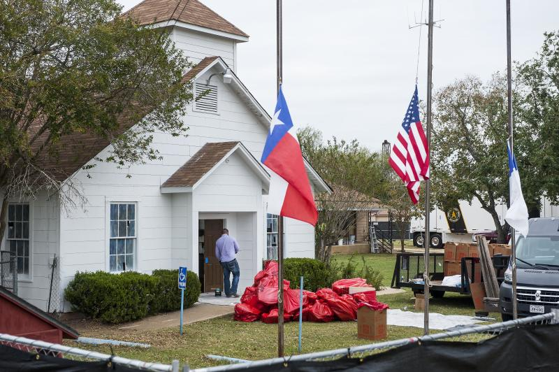 Plastic bags are piled up outside First Baptist Church in Sutherland Springs, Texas, as hazardous materials are removed from the building after themassacre. (Laura Schimmel/Padre Ryan Photography for HuffPost)