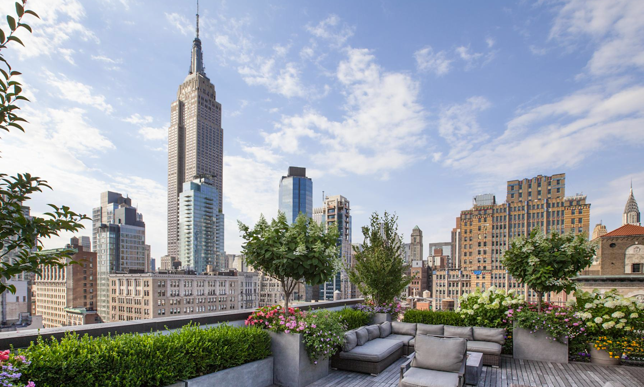 <p>The penthouse is stunning even from the outside. Its top floor has a small powder room, but most of the more than 1,000 square feet are dedicated to a beautiful outdoor terrace.<br />The space is perfect for entertaining with a bar, fire pit and dramatic views of the Chrysler and Empire State buildings. (Douglas Elliman) </p>