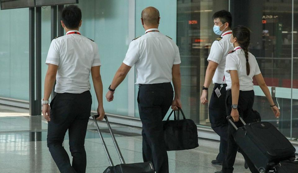 Cathay Pacific has said it will scrap salary increases in 2021 and extend unpaid leave for non-flying staff. Photo: K. Y. Cheng