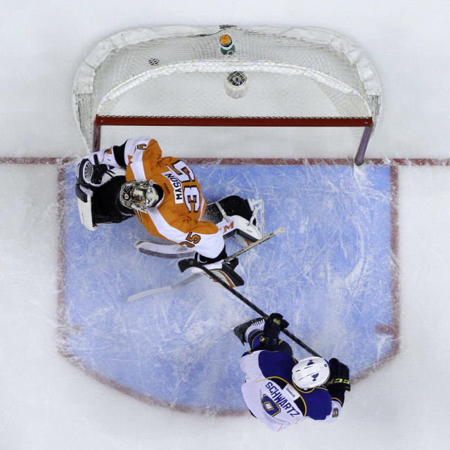 St. Louis Blues' Jaden Schwartz (9) scores a goal past Philadelphia Flyers' Steve Mason (35) during the first period of an NHL hockey game, Saturday, March 22, 2014, in Philadelphia. (AP Photo/Matt Slocum)