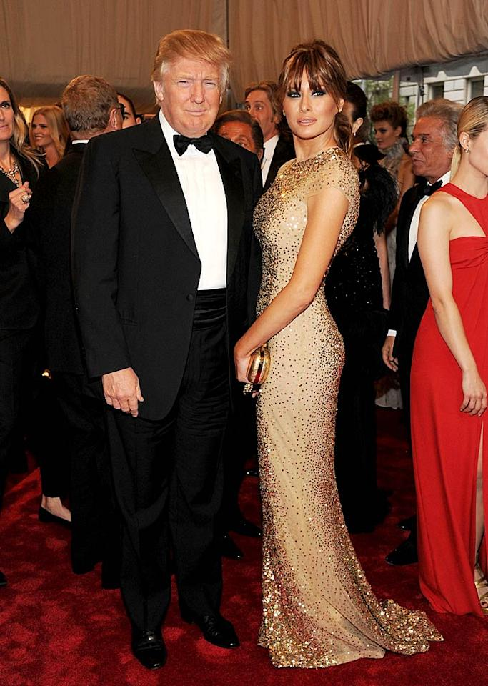 """With his unflappable hair and his rumpled tux, Donald Trump's best accessory was -- as always -- his wife Melania Trump. She wowed in a glittering, flesh-colored, body-hugging gown. Larry Busacca/<a href=""""http://www.gettyimages.com/"""" target=""""new"""">GettyImages.com</a> - May 2, 2011"""