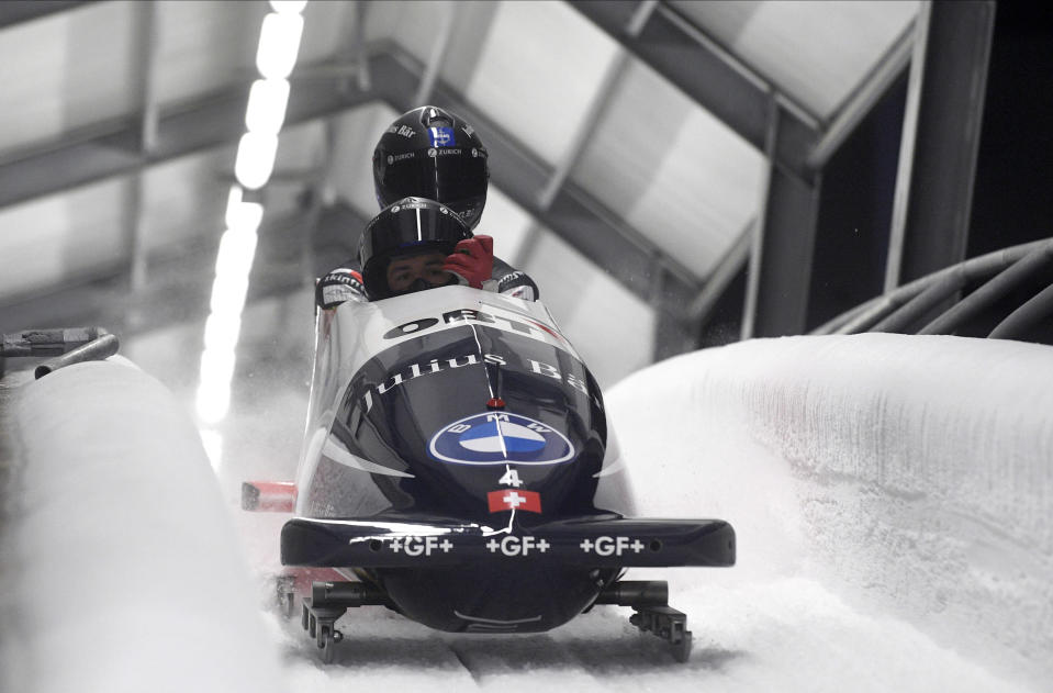 Michael Vogt and Sandro Michel of Switzerland finish their second run of the two man Bobsled World Cup race in Sigulda, Latvia, Sunday, Nov. 22, 2020. (AP Photo/Roman Koksarov)