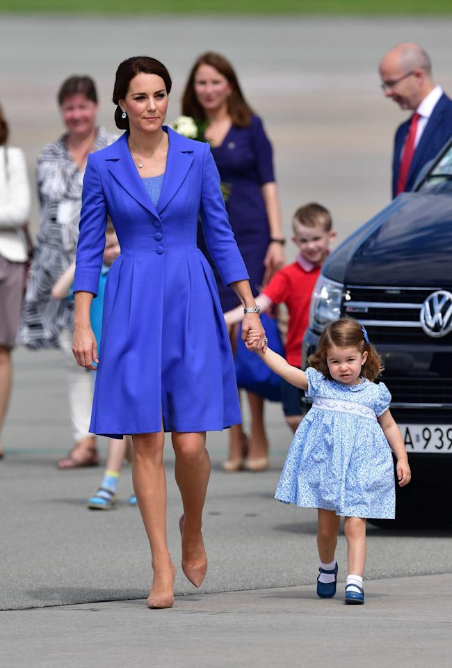 <p>The Duchess landed in Germany in a beautifully cut Catherine Walker coat dress – and Princess Charlotte looked just as lovely in a cap-sleeved printed smock. <br /><em>[Photo: PA]</em> </p>