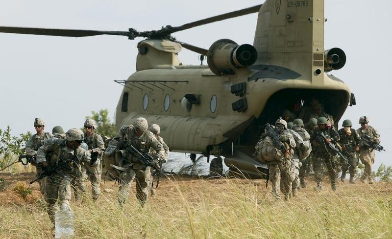 U.S. soldiers of 2nd Stryker Brigade Combat Team disembark from a U.S. military helicopter CH-47 as they take part in the annual