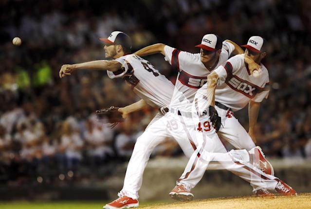 In this image taken with multiple exposures, Chicago White Sox starting pitcher Chris Sale delivers during the sixth inning of a baseball game Houston Astros, Wednesday, Aug. 28, 2013, in Chicago. (AP Photo/Charles Rex Arbogast)