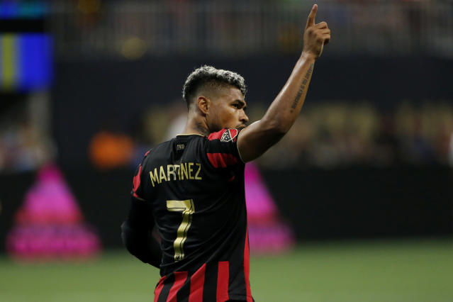 Atlanta United forward Josef Martinez looks to the crowd after scoring a goal during the second half of an MLS soccer game against the Los Angeles Galaxy, Saturday, Aug. 3, 2019, in Atlanta. (AP Photo/Andrea Smith)