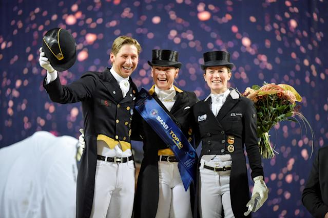 Equestrian - Sweden International Horse Show - FEI Grand Prix Freestyle to Music event - Friends Arena, Stockholm, Sweden - December 3, 2017 - (L-R) Second placed Patrik Kittel of Sweden, winner Isabell Werth of Germany and third placed Helen Langehanenberg of Germany are seen during the award ceremony. TT News Agency/Jessica Gow via REUTERS ATTENTION EDITORS - THIS IMAGE WAS PROVIDED BY A THIRD PARTY. SWEDEN OUT. NO COMMERCIAL OR EDITORIAL SALES IN SWEDEN
