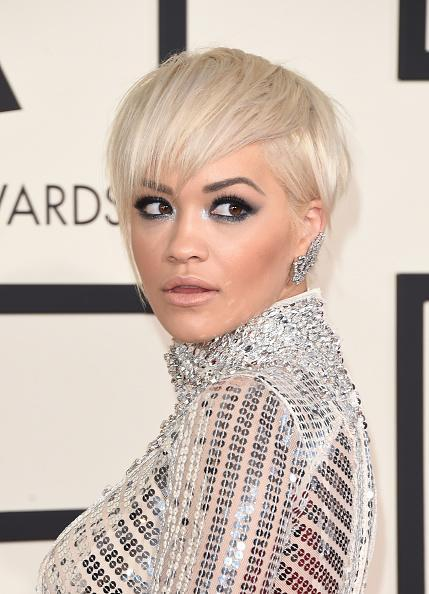 <p>Rita Ora debuted a shiny pixie peroxide cut at the Grammy's in 2015.<i> [Photo: Getty]</i></p>