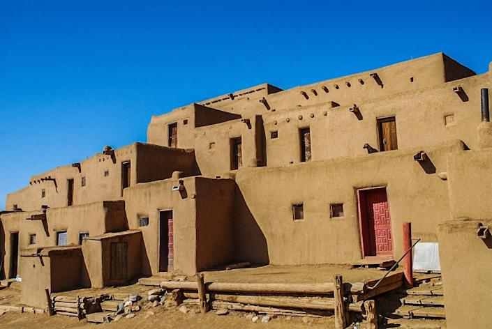 <strong>Taos Pueblo</strong>, in New Mexico, is the largest multistoried adobe structure in the United States and has been continuously inhabited since 1,000 A.D.