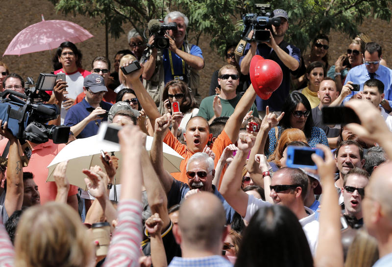 Spectators react in Phoenix, Wednesday, May 8, 2013 to a guilty verdict in the trial of Jodi Arias, a waitress and aspiring photographer charged with killing her boyfriend, Travis Alexander, in Arizona in 2008. The four month trial included graphic details of their sexual escapades and photos of Alexander just after his death. (AP Photo/Matt York)