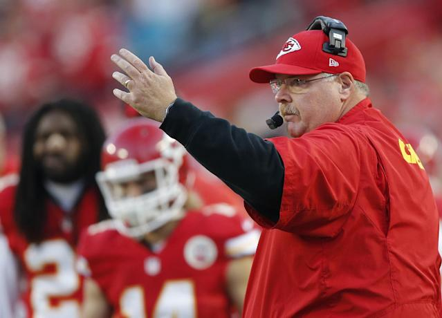 Kansas City Chiefs head coach Andy Reid signals his players during the first half of an NFL football game against the Denver Broncos, Sunday, Dec. 1, 2013, in Kansas City, Mo. (AP Photo/Orlin Wagner)