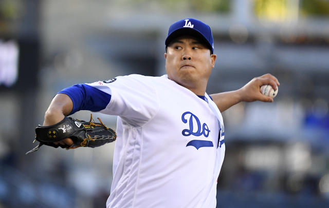 Los Angeles Dodgers starting pitcher Hyun-Jin Ryu, of South Korea, throws during the first inning of the team's baseball game against the Miami Marlins on Friday, July 19, 2019, in Los Angeles. (AP Photo/Mark J. Terrill)