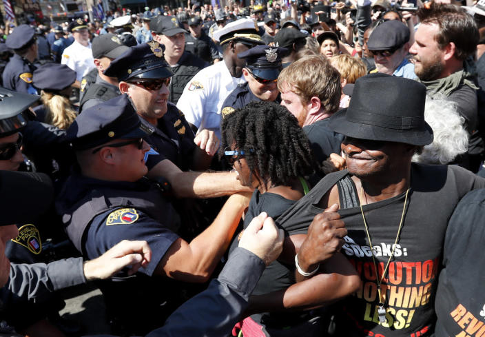 <p>Law enforcement officers clash with protesters, July 20, 2016, in Cleveland, during the third day of the Republican convention. (Photo: Alex Brandon/AP)</p>