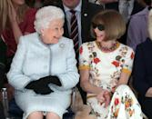 Though famed for not smiling Anna Wintour (R), couldn't help but grin when she sat next to the Queen at the designer Richard Quinn's runway show in February 2018. (Yui Mok/AFP)