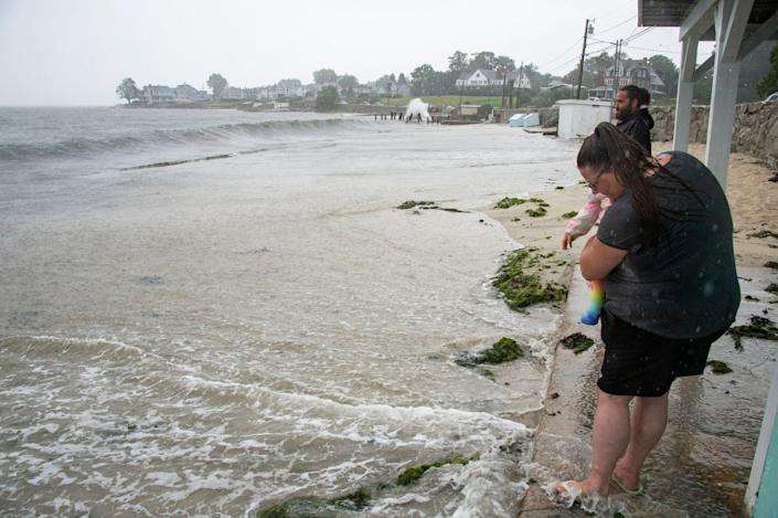 Water on the beach extending way farther down the shore