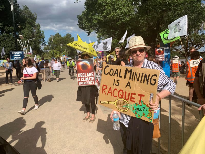 Retired teacher Libby Dougas protests against Australia's lack of action against climate change outside the Australian Open in Melbourne