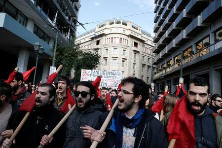 People shout slogans during a demonstration marking a 24-hour general strike against austerity in Athens, Greece, December 14, 2017. REUTERS/Costas Baltas
