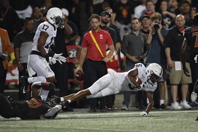 Penn State cornerback Tariq Castro-Fields (5) falls to the ground after intercepting a pass during the first half of an NCAA college football game against Maryland, Friday, Sept. 27, 2019, in College Park, Md. (AP Photo/Nick Wass)