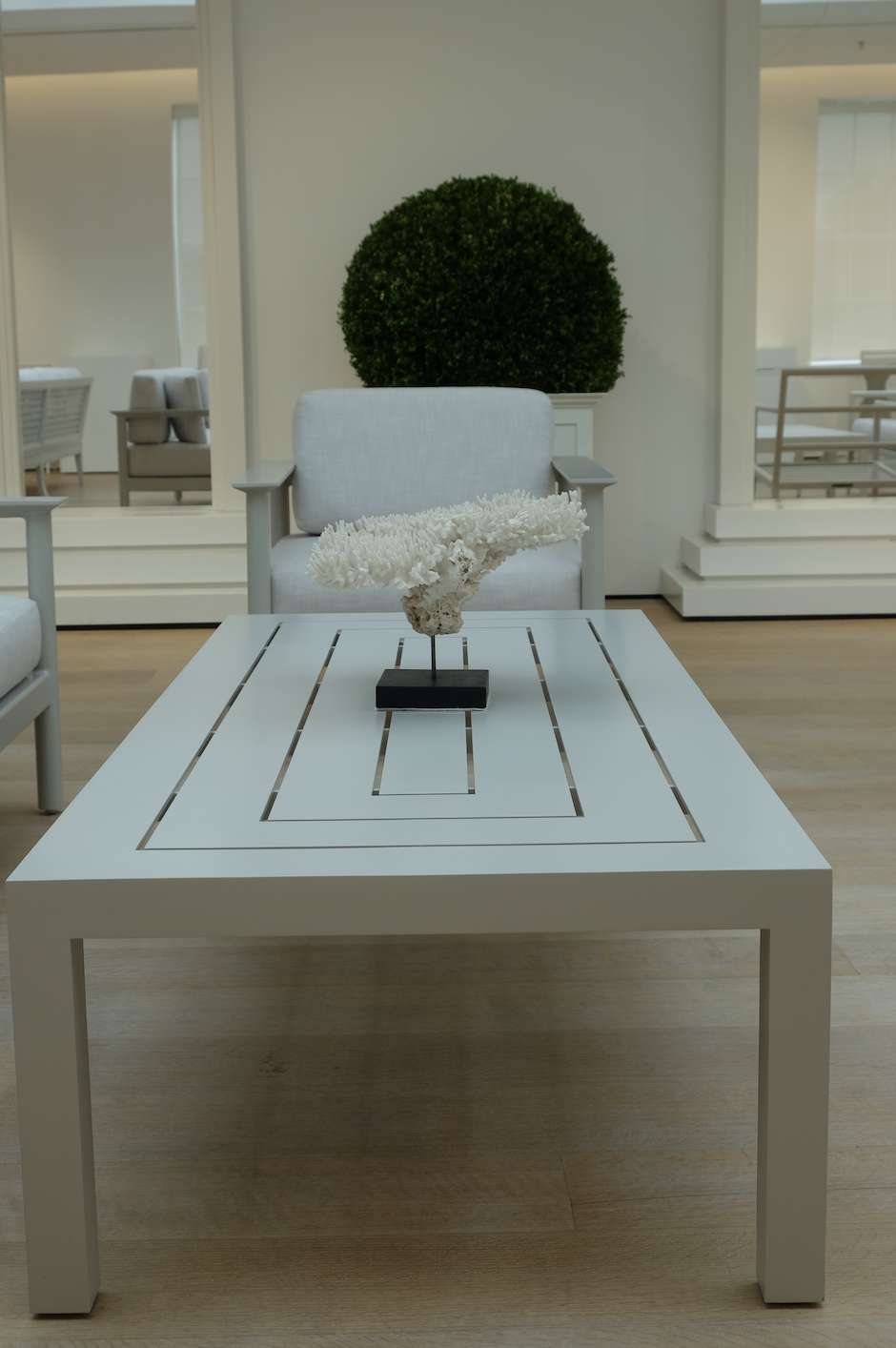 """<p>This aluminum coffee table is dubbed McKinnon and Harris's """"modernist ode to basic practicality."""" The 72-inch table also has a matching side table so you have plenty of space for guests to kick up their feet and have a place to hold their drinks. </p>"""
