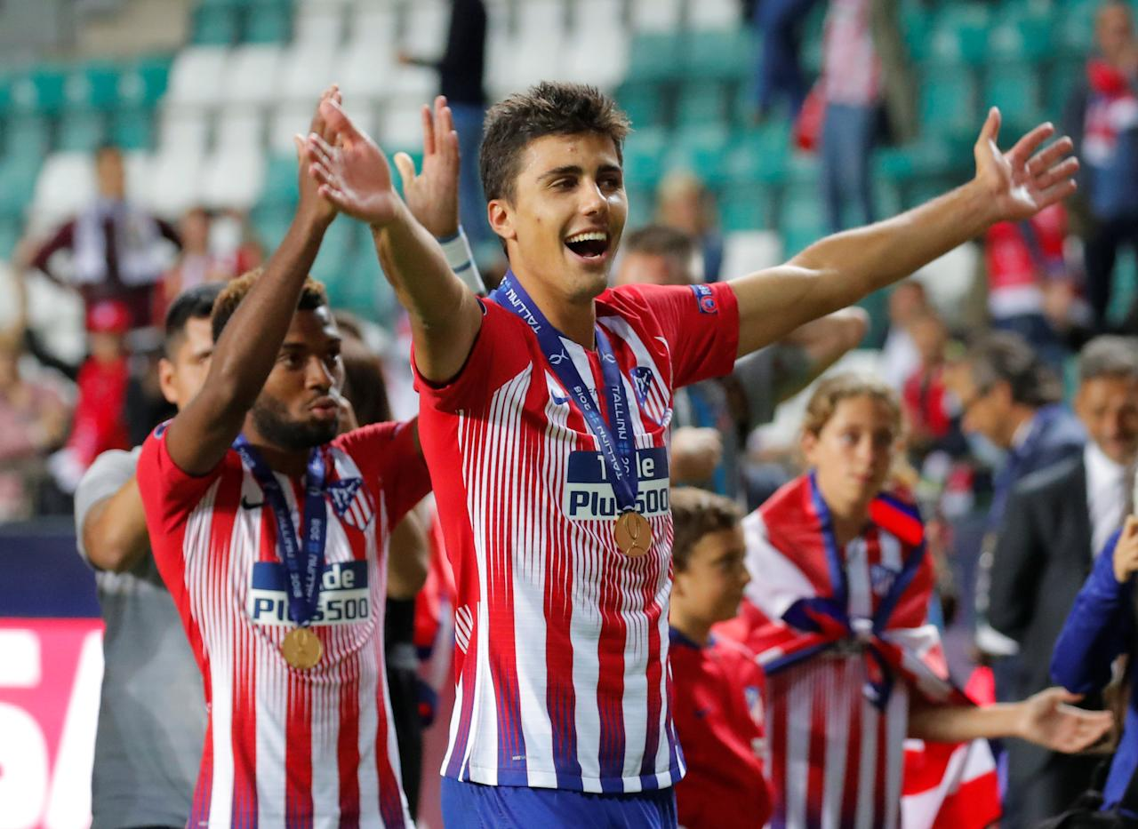 Soccer Football - Super Cup - Real Madrid v Atletico Madrid - Lillekula Stadium, Tallinn, Estonia - August 15, 2018  Atletico Madrid's Rodri celebrates after winning the Super Cup             REUTERS/Maxim Shemetov