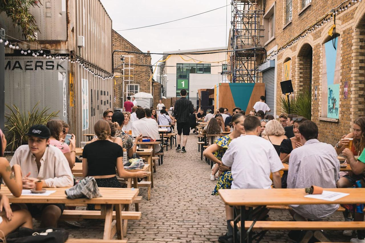 """<p>The people behind Corsica Studios have opened a new al fresco bar in Peckham. <a href=""""https://www.thepaperworks.co.uk/"""" target=""""_blank"""">The Paperworks</a> has now moved from its original location and has been reimagined on the site of a former Bottle Factory, offering drinks, street food and live music and DJ sets. Open on Friday and Saturday evenings throughout September only, guests need to book tickets in advance. Social distancing measures will be observed and an online ordering system will enable you to order food and drink straight to your table via your phone.</p>"""
