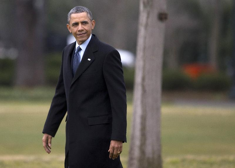 President Barack Obama walks to board the Marine One helicopter on the South Lawn of the White House in Washington, Tuesday, Feb. 26, 2013. The president is traveling to Newport News, Va. to make a speech about automatic budget cuts, at Newport News Shipbuilding. (AP Photo/Evan Vucci)