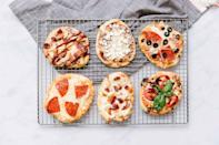 """<p>Get the whole family together to make these mini naan pizzas, which you can customize to your liking. Top them with mushrooms, peppers, onions, olives or whatever veggie tickles your fancy. And once you master this simple recipe, try these other <a href=""""https://www.thedailymeal.com/best-recipes/best-pizza-recipes-and-pizza-cooking-ideas?referrer=yahoo&category=beauty_food&include_utm=1&utm_medium=referral&utm_source=yahoo&utm_campaign=feed"""" rel=""""nofollow noopener"""" target=""""_blank"""" data-ylk=""""slk:recipes for pizza night at home"""" class=""""link rapid-noclick-resp"""">recipes for pizza night at home</a>.</p> <p><a href=""""https://www.thedailymeal.com/recipes/mini-naan-pizzas-recipe?referrer=yahoo&category=beauty_food&include_utm=1&utm_medium=referral&utm_source=yahoo&utm_campaign=feed"""" rel=""""nofollow noopener"""" target=""""_blank"""" data-ylk=""""slk:For the Mini Naan Pizzas recipe, click here."""" class=""""link rapid-noclick-resp"""">For the Mini Naan Pizzas recipe, click here.</a></p>"""