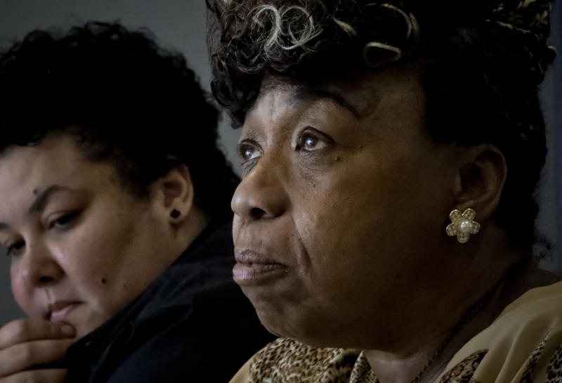In this Wednesday May 8, 2019, photo, Loyda Colon, left, co-Director of the Justice Committee, listens while Gwen Carr, right, mother of Eric Garner, an unarmed black man who died as he was being subdued in a chokehold by NYPD police officer Daniel Pantaleo nearly five years ago, speaks during an interview, Wednesday May 8, 2019, in New York. A New York City judge has cleared the way for a police disciplinary trial to begin next week for Pantaleo in the death of her son, after rejecting his claim that a police watchdog agency didn't have jurisdiction to prosecute the case. (AP Photo/Bebeto Matthews)