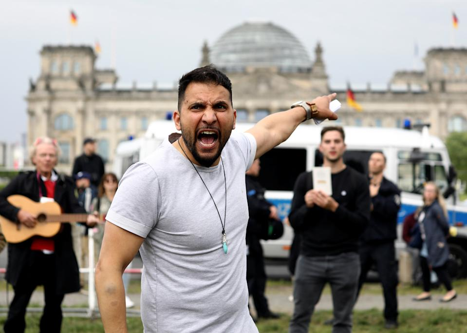 Activist Attila Hildmann gestures as he speaks during a protest against the government's restrictions following the coronavirus disease (COVID-19) outbreak, in Berlin, Germany, May 23, 2020. REUTERS/Christian Mang