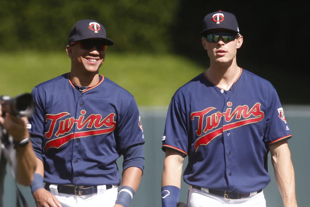 Minnesota Twins outfielders Eddie Rosario, left, and Max Kepler leave the field after the Twins beat the Chicago White Sox 7-0 in a baseball game Sunday, May 26, 2019, in Minneapolis. Rosario had three RBIs and Kepler had four RBIs. (AP Photo/Jim Mone)