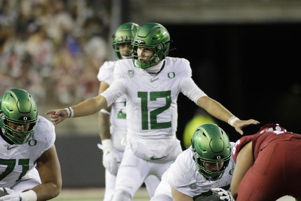 Oregon quarterback Tyler Shough (12) calls a play during the second half of an NCAA college football game against Washington State in Pullman, Wash., Saturday, Nov. 14, 2020. Oregon won 43-29. (AP Photo/Young Kwak)