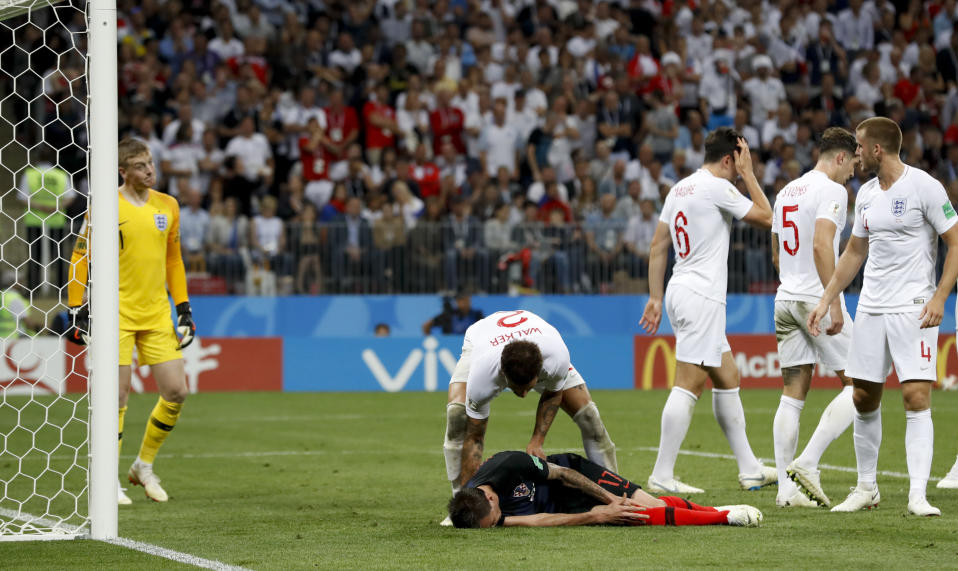 <p>Mario Mandzukic lies on the pitch after colliding with Pickford </p>