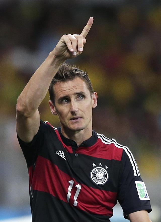 Germany's Miroslav Klose gestures as he is substituted during the World Cup semifinal soccer match between Brazil and Germany at the Mineirao Stadium in Belo Horizonte, Brazil, Tuesday, July 8, 2014. (AP Photo/Matthias Schrader)