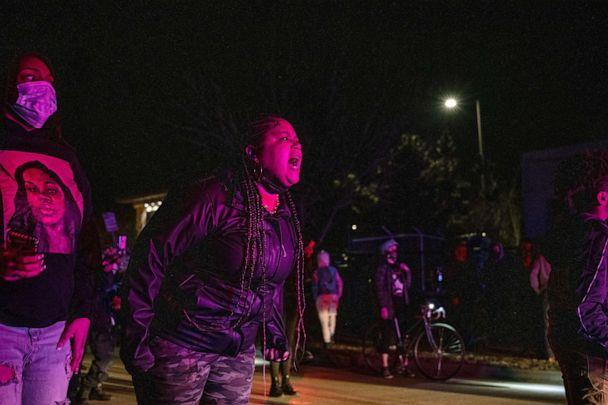PHOTO: A protester shout at police officers in front of her and the crowd after the Breonna Taylor memorial events, March 13, 2021, in Louisville, Kentucky. (Jon Cherry/Getty Images)