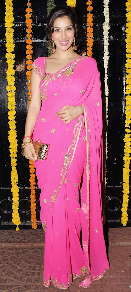 Looking pretty in pink is Sophie. Go for this sari for an engagement ceremony.