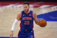 Detroit Pistons forward Blake Griffin brings the ball up court during the first half of an NBA basketball game against the Houston Rockets, Friday, Jan. 22, 2021, in Detroit. (AP Photo/Carlos Osorio)