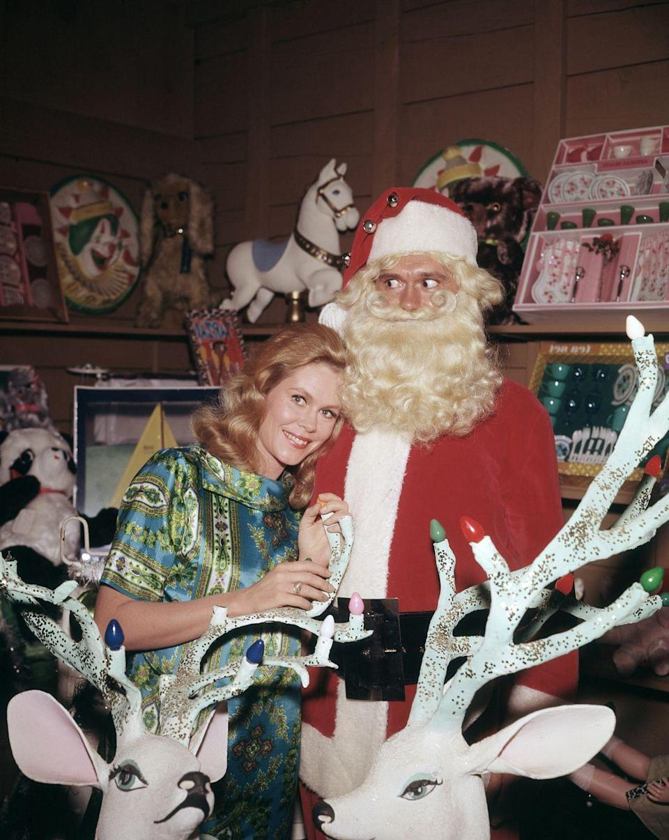 <p>You could say that Samantha Montgomery is <em>Bewitched </em>by Santa. The actress and her costar, Dick York, are seen here filming a holiday episode for their hit television show. </p>