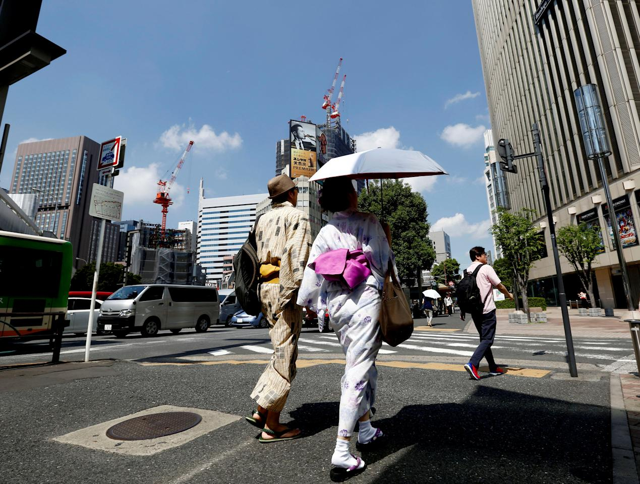 "A couple wearing Yukata, Japanese summer kimono, walks along a shopping district in Tokyo, August 26, 2016. REUTERS/Kim Kyung-Hoon/File Photo                     GLOBAL BUSINESS WEEK AHEAD - SEARCH ""GLOBAL BUSINESS AUG 29"" FOR ALL IMAGES?"