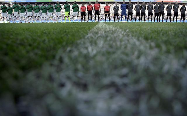 <p>Teams stand to listen to the national anthems before a semifinal match of the men's Olympic football tournament between Germany and Nigeria in Sao Paulo, Wednesday Aug. 17, 2016.(AP Photo/Leo Correa) </p>