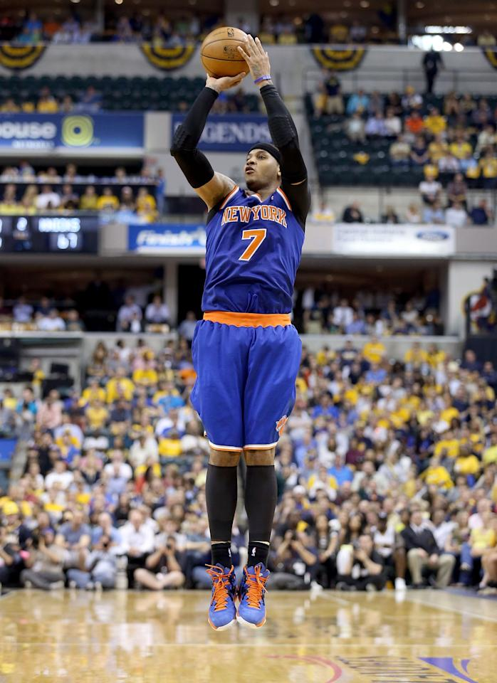 INDIANAPOLIS, IN - MAY 14:  Carmelo Anthony #7 of the New York Knicks shoots the ball against the Indiana Pacers during Game Four of the Eastern Conference Semifinals of the 2013 NBA Playoffs at Bankers Life Fieldhouse on May 14, 2013 in Indianapolis, Indiana. NOTE TO USER: User expressly acknowledges and agrees that, by downloading and or using this photograph, User is consenting to the terms and conditions of the Getty Images License Agreement.  (Photo by Andy Lyons/Getty Images)