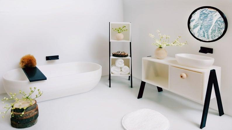 "<p>The only thing more relaxing than a Scandi-style bathroom setup is a tiny one you can play with. This adorable miniature freestanding tub, cabinet, and shelf kit features a sleek, modern design that minimalists will love.</p> <p><strong><em>Shop Now:</em></strong><em> LunaHut Miniature Bath 1:12 Scale, $42.66, <a href=""https://www.awin1.com/cread.php?awinmid=6220&awinaffid=272513&clickref=MSLTheMiniaturesTrendIsHavingaMomentTryOneofOurFavoriteKitssbamseyDIYGal7988105202009I&p=https%3A%2F%2Fwww.etsy.com%2Flisting%2F814969499%2Fminiature-bath-112-scale"" rel=""nofollow noopener"" target=""_blank"" data-ylk=""slk:etsy.com"" class=""link rapid-noclick-resp"">etsy.com</a></em><em>.</em></p>"