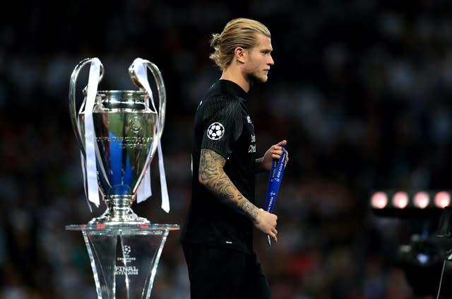 Loris Karius walks past the Champions League trophy following Liverpool's loss to Real Madrid in 2018 (Mike Egerton/PA)